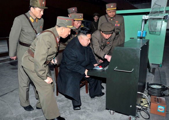 """In this photo released in March, 2013, KJU is supposedly getting a look at thelatest combat and technical equipment, made by unit 1501 of the Korean People's Army,"""" March 24, 2013. The rest of the world scratches its head and says: """"Really?"""" Love the retro radar antenna. (KCNA)"""